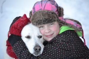 Girl hugging dog