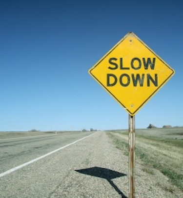 road sign slow down