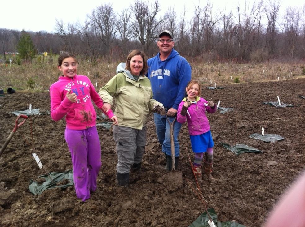 Swinton family planting trees