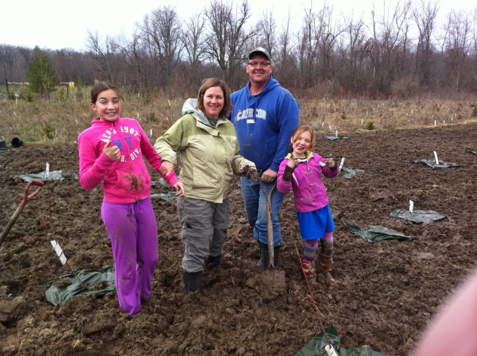 Swinton family planting trees