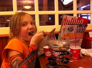 Girl eating ice cream sundae