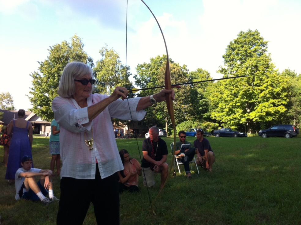 Audrey shooting a bow and arrow