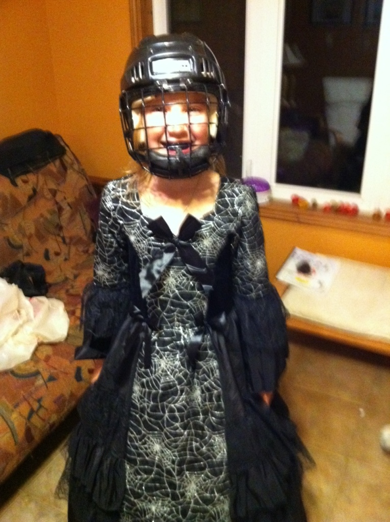 Girl in Halloween costume and helmet