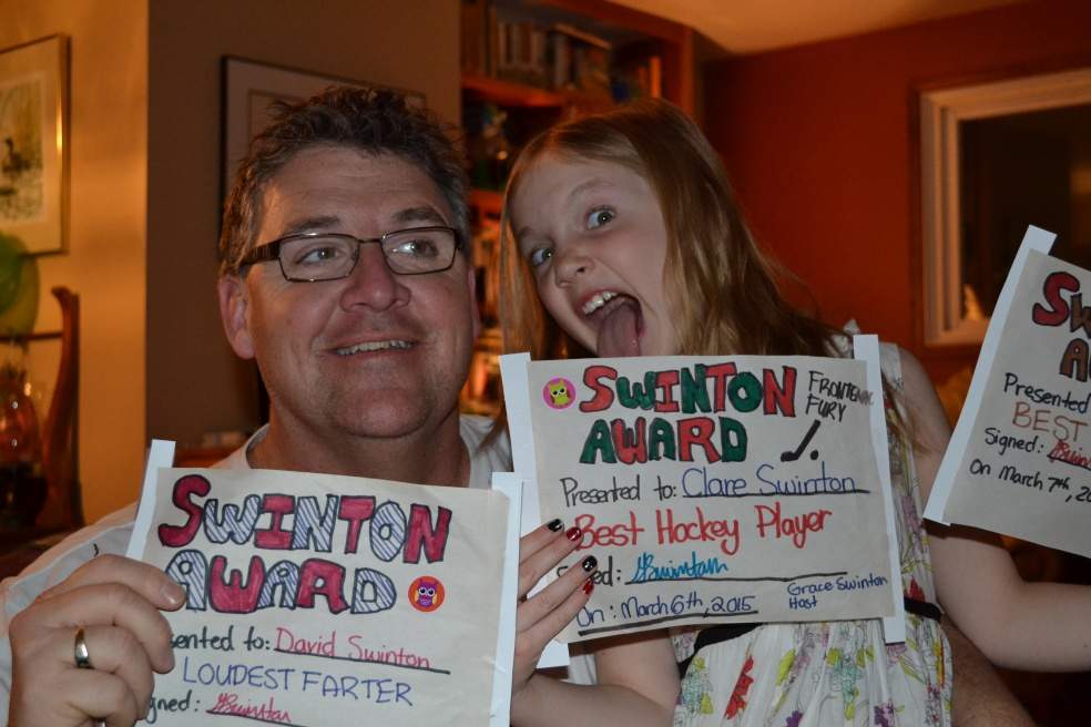 Man and girl with awards