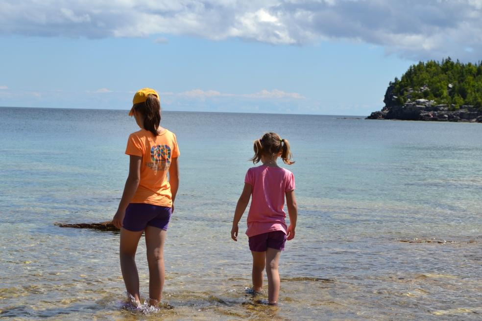 girls standing in water