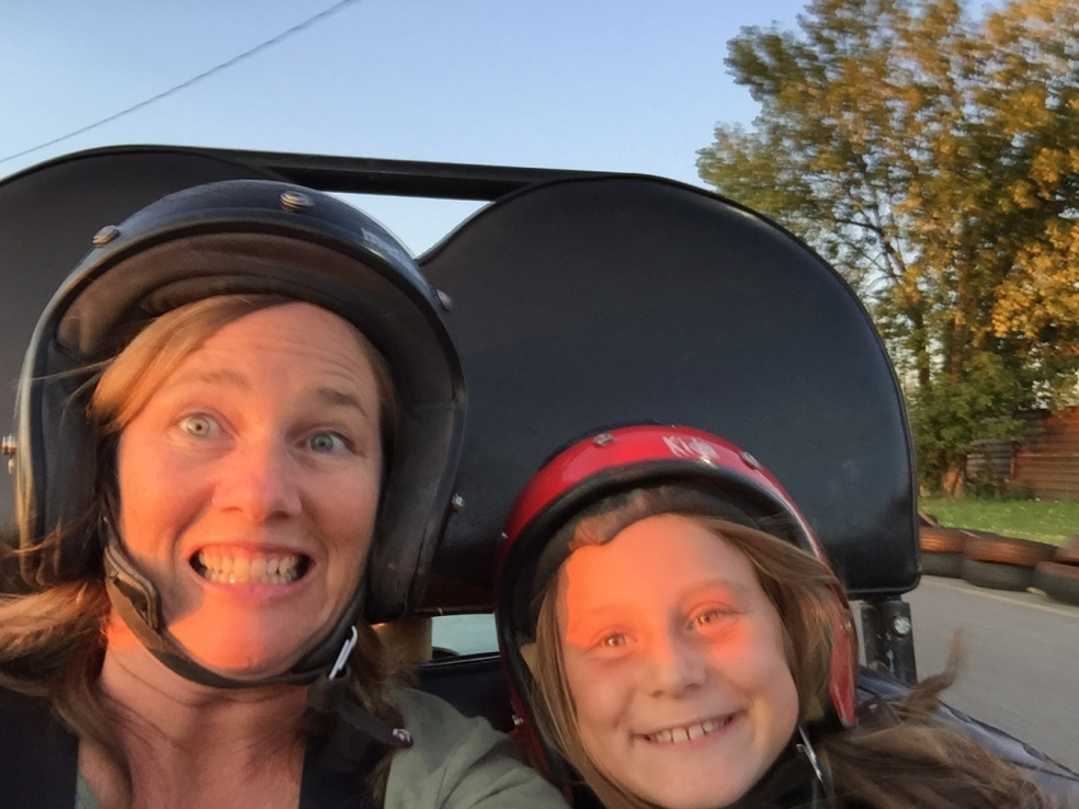 Mom and girl in a go-kart