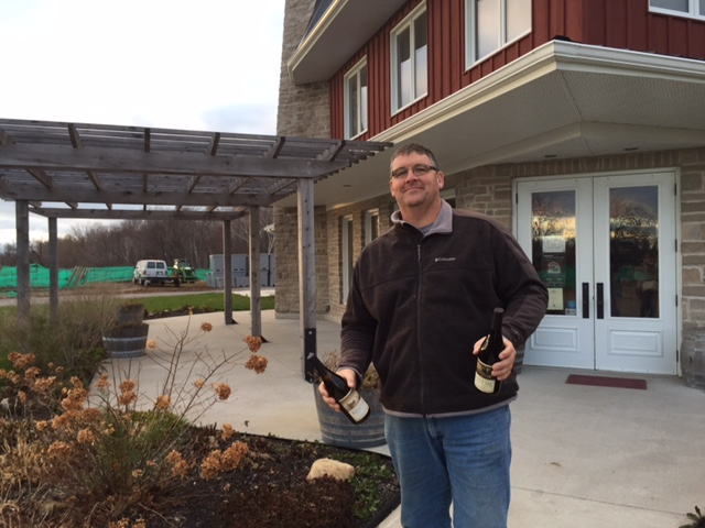 Man holding two bottles of wine