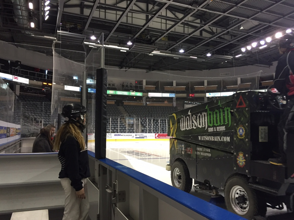 girl watching zamboni