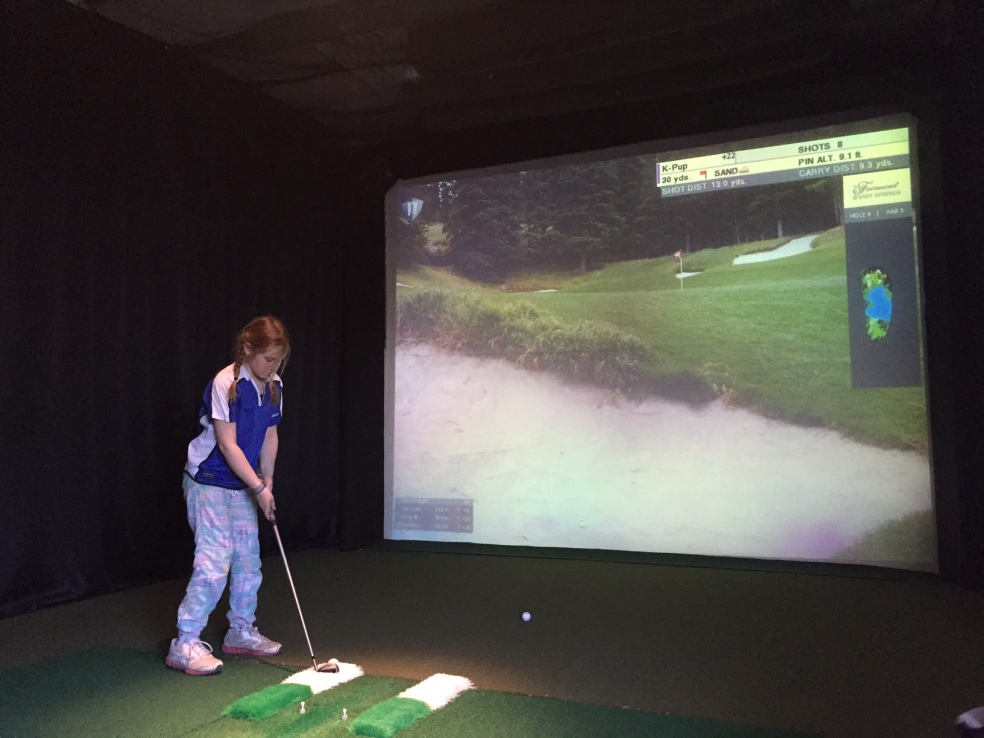 Girl learning to golf