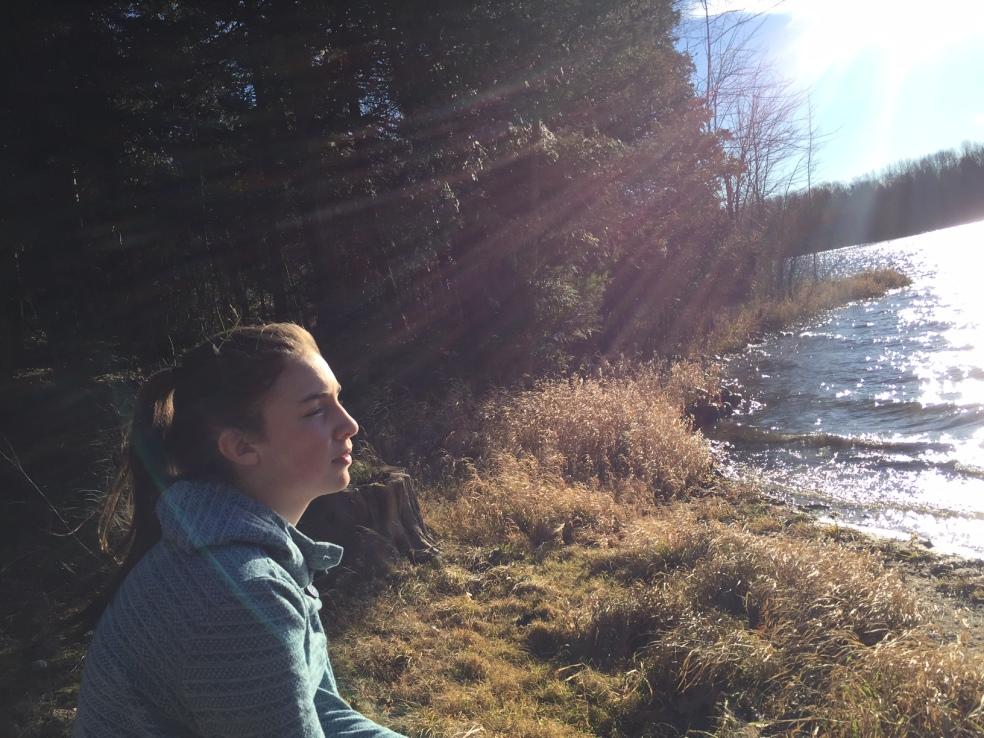 Girl looking up lake