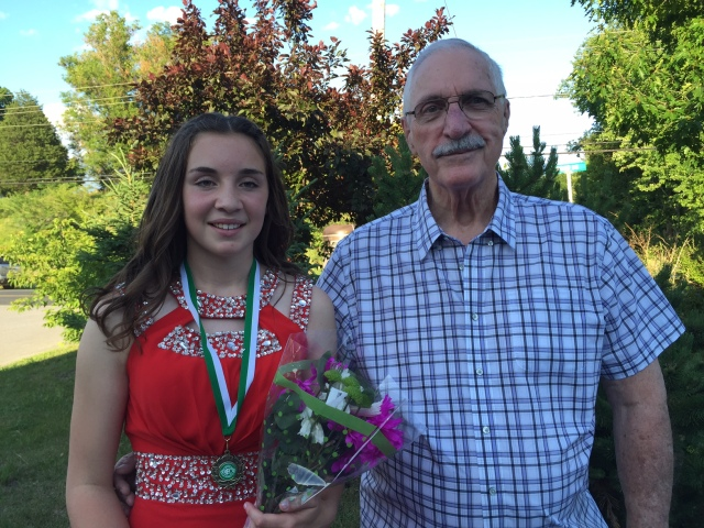 Girl in grad dress with her grandfather