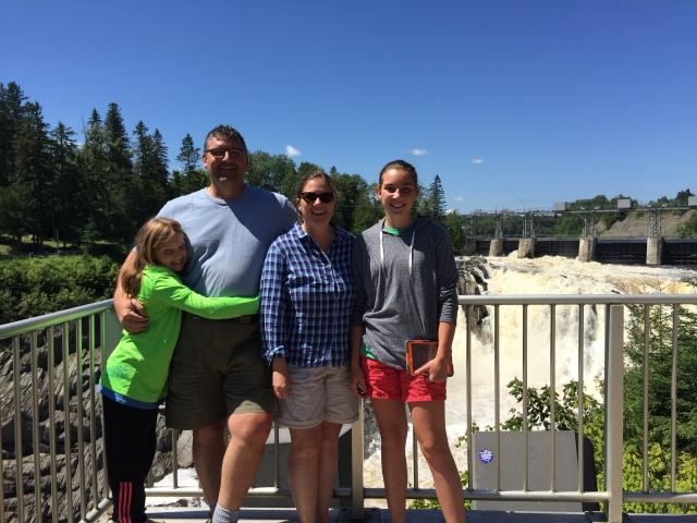 Swinton family in front of waterfall