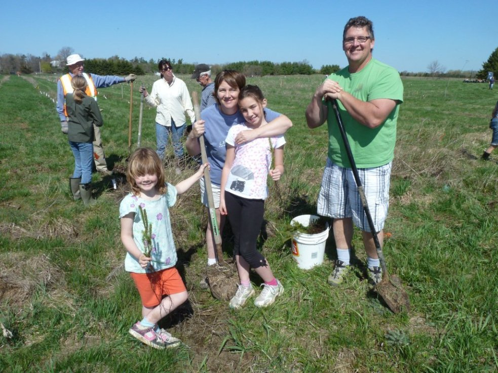 Family planting trees
