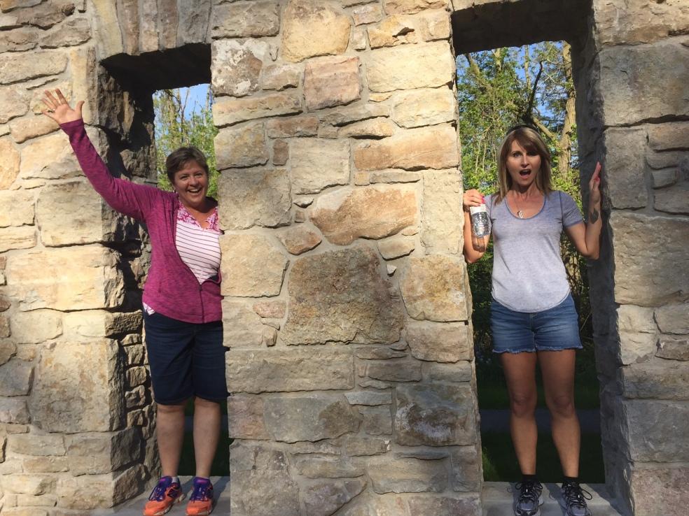 women standing in ruins