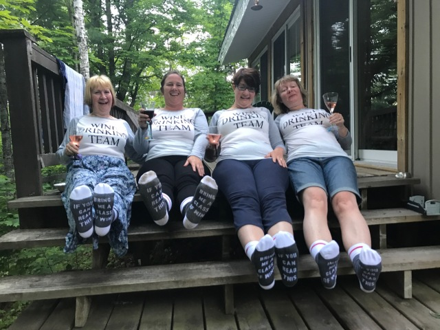 Girls wearing wine drinking team tshirts and socks