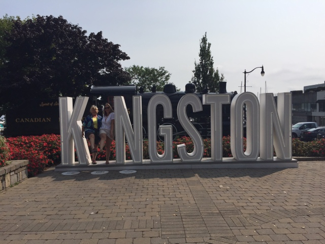 Friends at the Kingston sign