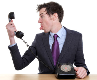 man sticking out his tongue at a phone