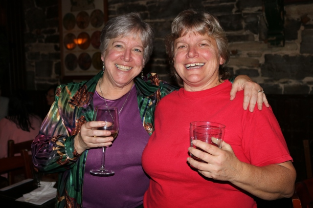Two women with drinks celebrating