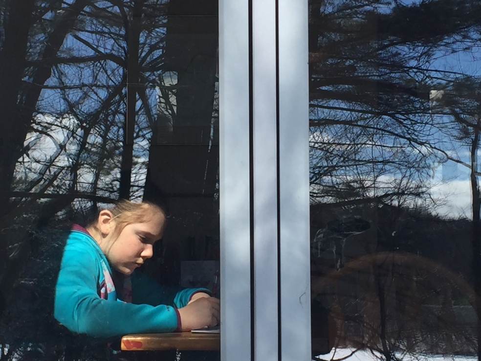 reflection of girl in window