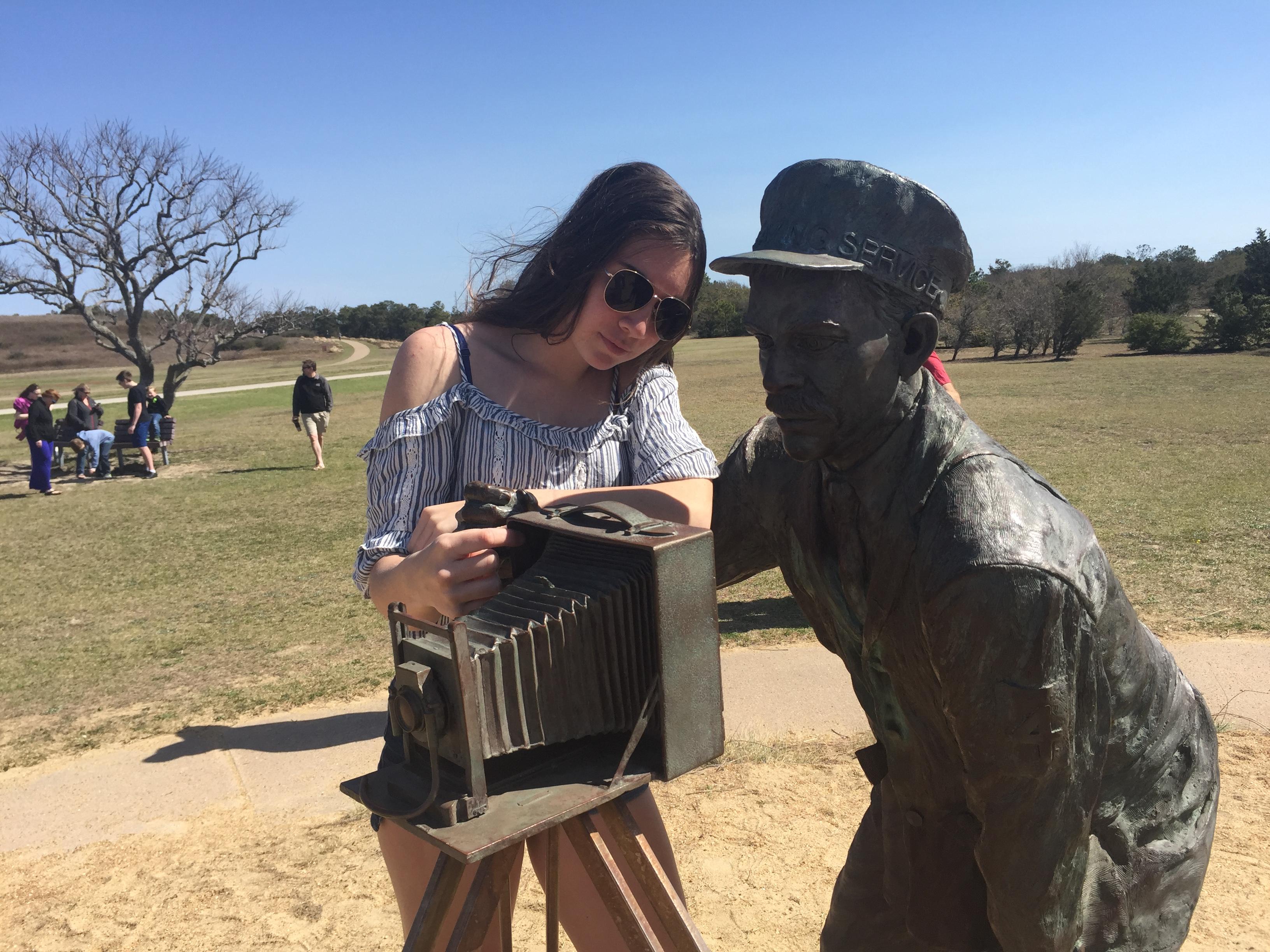 Girl at Kitty Hawk statue