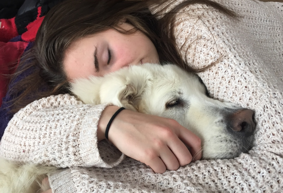 Girl sleeping with dog