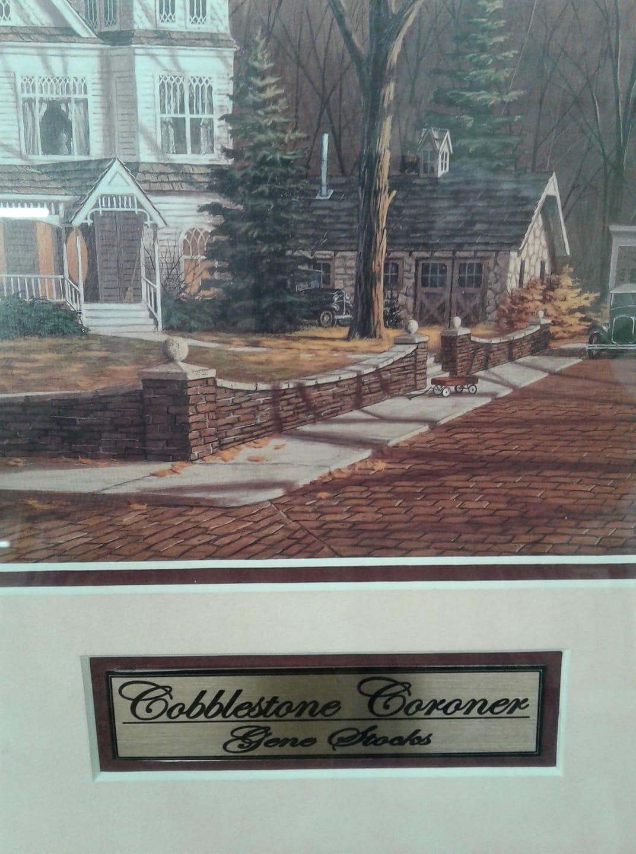 Sign that says Cobblestone Coroner