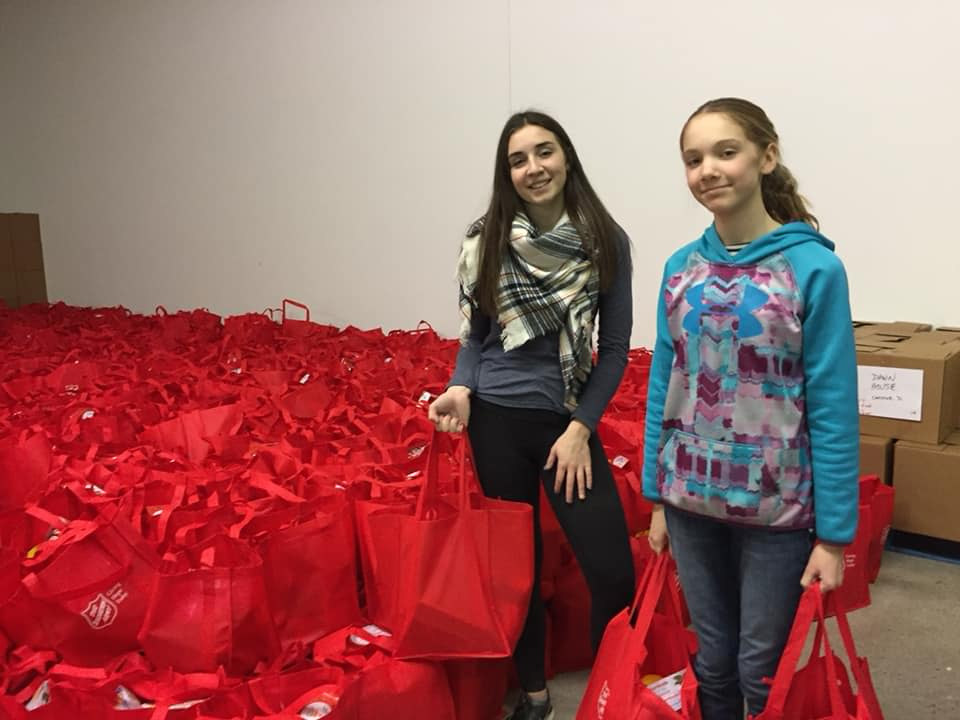 Daughters with Salvation Army hampers