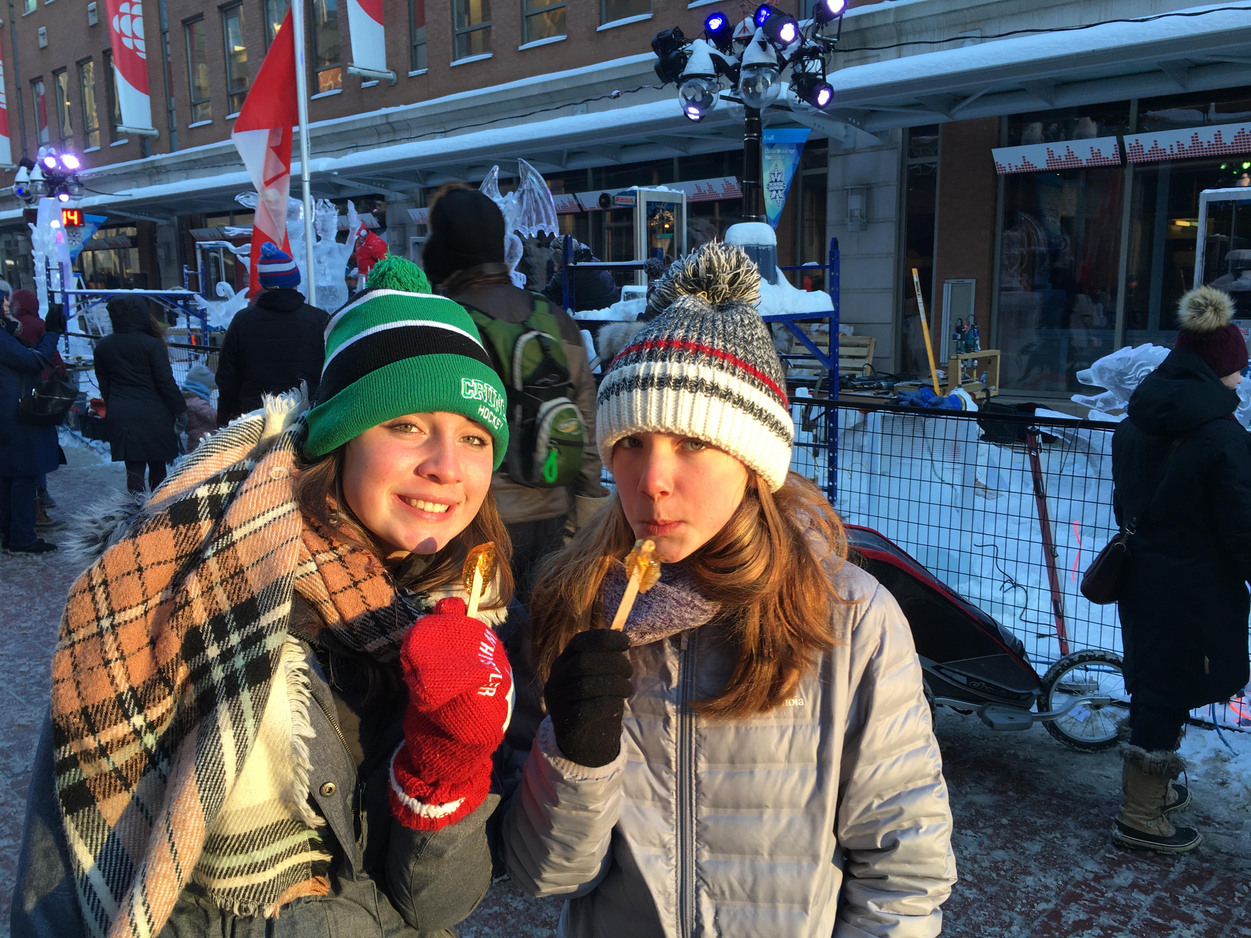 Girls eating maple taffy