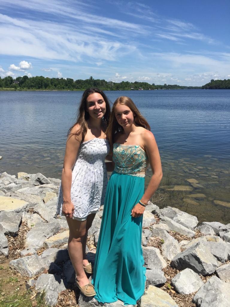 Two girls graduating