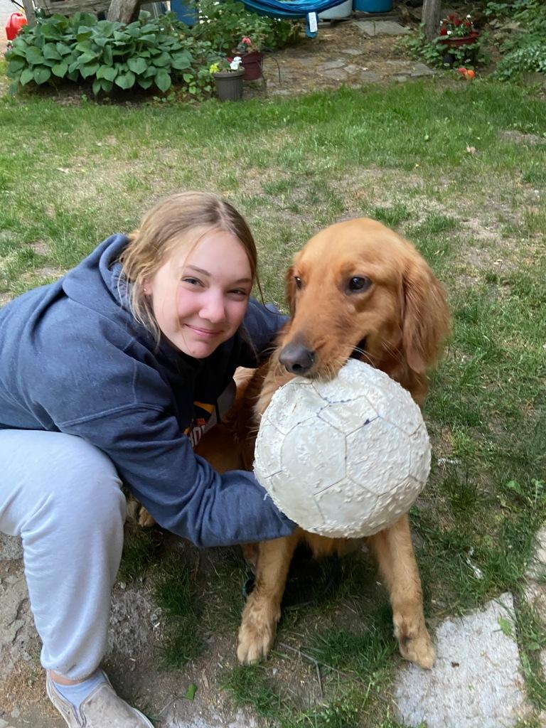 Girl with dog and ball