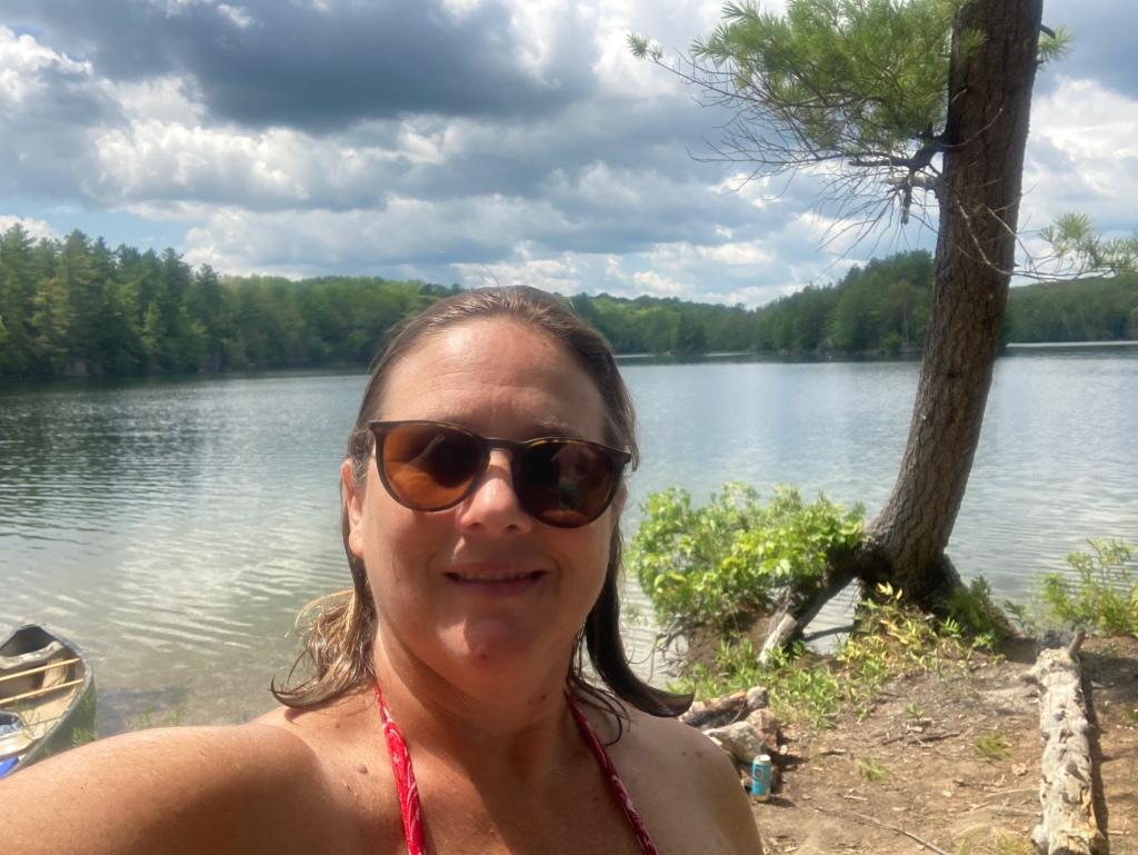 Author on island with a canoe