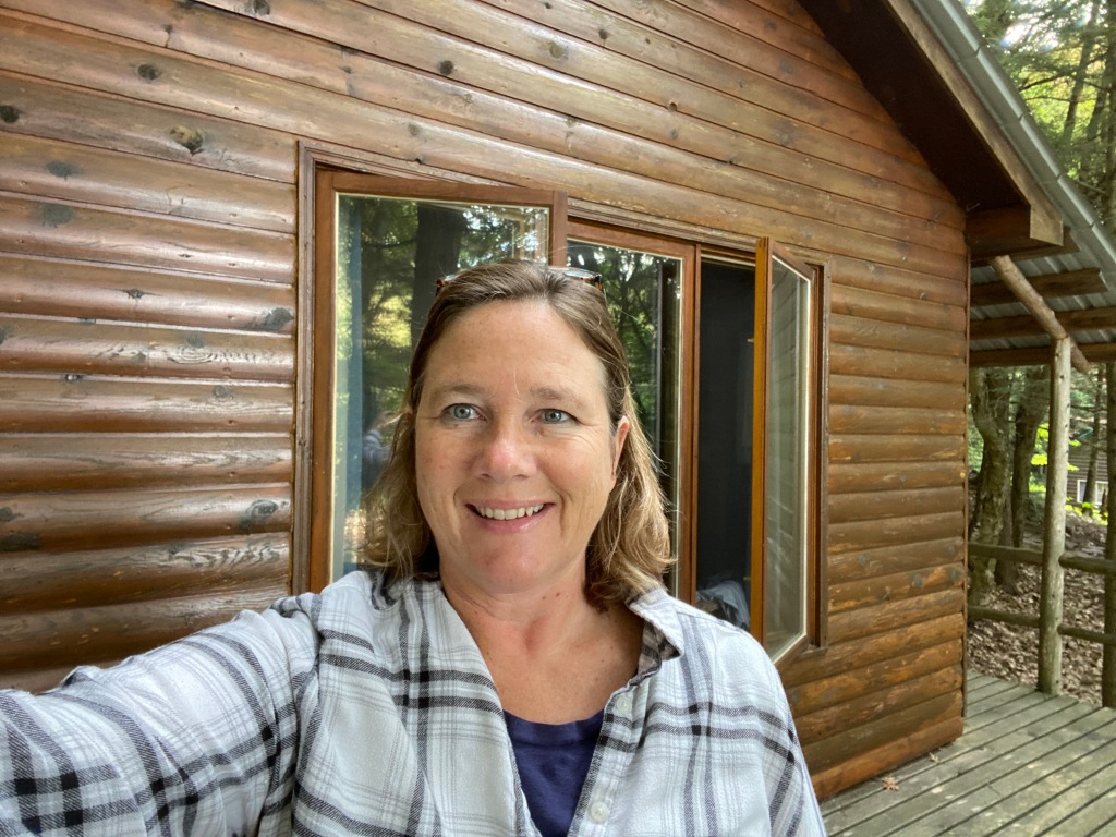 Author outside her friend's log cabin