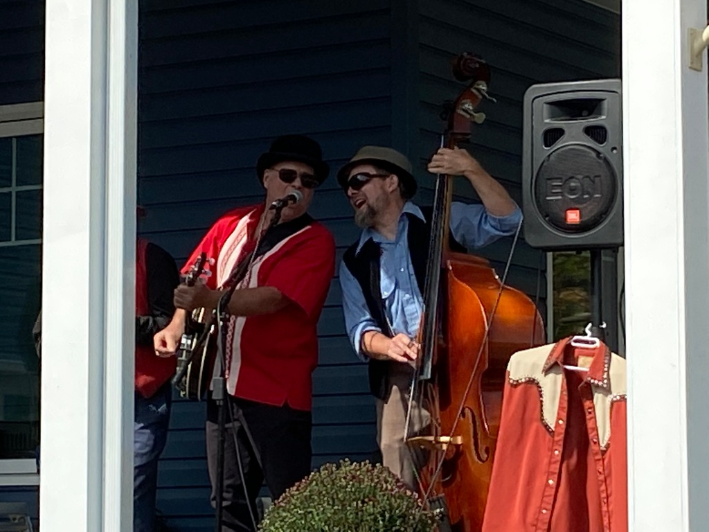 Musicians performing on the porch at Westporch