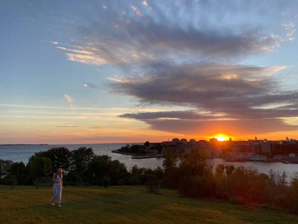 Clare on Fort Henry hill as the sun sets over Kingston