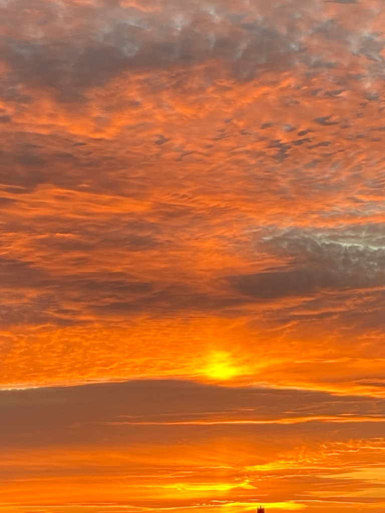 Orange sun and clouds